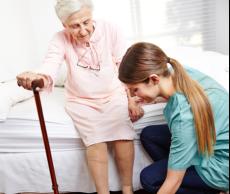 Assisting elder female in standingup